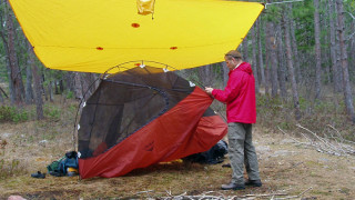 When it's raining, set up a tarp first, then pitch your tent underneath it to keep the tent interior dry. (Tim Jones photo)