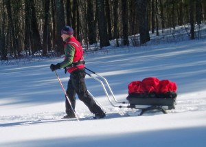 A pulk-and-harness system is one way to haul the gear you need in winter. This Nordic Cab pulk from Norway converts to a child carrier  for cross-country skiing or a wheeled cart or jogging stroller in the summer. (EasternSlopes.com)