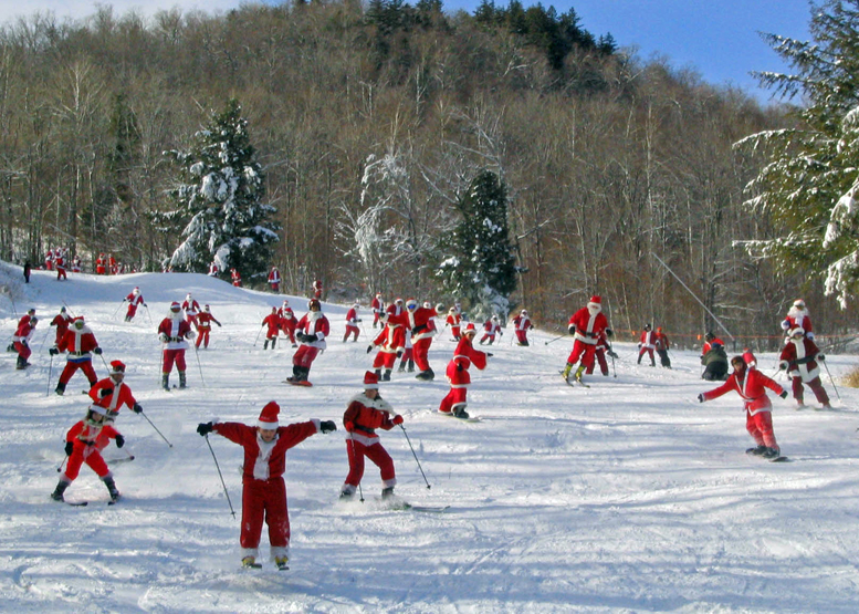The 10th Annual Santa Sunday is December 6 at Sunday River.  250 Santa-suit clad skiers and riders take to the slopes at once