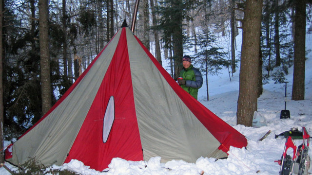 I know his smile looks like a grimace, but David Shedd and I were actually having fun on this winter camping expedition to New Hampshire's White Mountain National Forest. The temperature dropped below zero at night (it was still below zero when this photo was taken) but the woodstove and good sleeping bags kept us warm and comfy--most of the time! (Tim Jones photo)