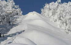 Mounds of manmade snow, waiting to be turned into fun moguls at SkiBromont (Francios Senecal photo)