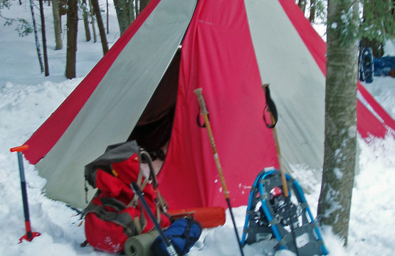 A tent with a woodstove! Winter backpacking is an adventure. The woodstove makes for warm evenings, but you still have to be prepared to play and sleep in the cold.
