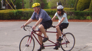 """Captain"" Doug Mckenzie and ""Stoker"" Marilyn Donnelly take a spin on a tandem bike. (Tim Jones photo)"
