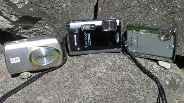"Three generations of Olympus Stylus cameras. On the left is an older, ""splashproof"" Olympus Stylus 410. On the right a newer Olympus Stylus 7020SW. In the middle, the author's current ""go-to"" camera, a waterproof/shockproof Olympus Stylus Tough 6020. They shot thousands of outdoor photographs"