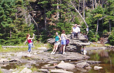 These hikers at Sterling Pond near Smugglers' Notch in Vermont have stopped to capture a moment with a pocket camera. (Tim Jones Photo)
