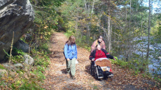Beauitful day, beautiful place! Marilyn Donnelly,  Dawn Towle and Peggy Knox (seated) enjoying a hike on the Appalachian Trail in Connecticut with the Housatonic River keeping them company.  Tim Jones photo)