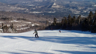 Though the snow was absolutely superb, this was the closest we came to seeing a crowd on the slopes at Sunday River. Maybe the fact that it was 12 below zero with a howling wind had something to do with it . . . (Tim Jones photo)