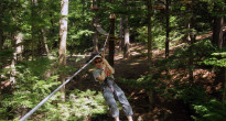 There are nine zip lines strung throughout the adult ATA course, including one that stretches for almost the length of a football field. Here, Laura gets a thrill shooting across above the forest floor.  (Ethan Gourlay photo)