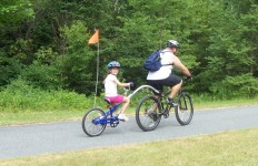 Doug's brother Ron tows daughter Allie on her Trek Pedal Trailer. (Kate Goodin photo)