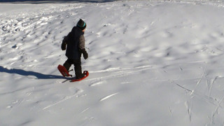 Max testing snowshoes (Tim Jones/EasternSlopes.com)