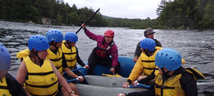 Christine offers a quick lesson in paddling prior to going over Nesowadnehunk Falls.