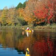 Take a trip on a river when the leaves have turned color.