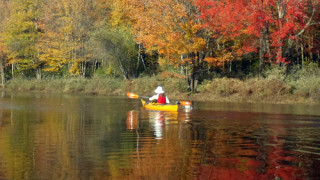What could be more beautiful than blue sky and autumn foliage reflected in cool, clear water? (Tim Jones photo)