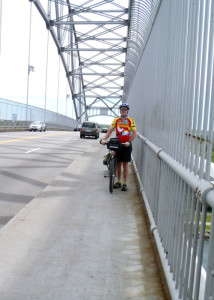 Walking our touring tandem across the Bourne Bridge. Crossing the bridge is the symbolic start and end of any Cape Cod/Islands getaway. Donnelly/EasternSlopes.com)