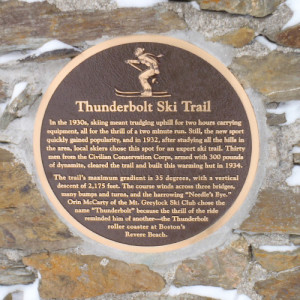 This plaque gave us some of the history of the trail we had just climbed. Note the snow driven deep into the crevices of the stonework by the wind. (Tim Jones/EasternSlopes.com)