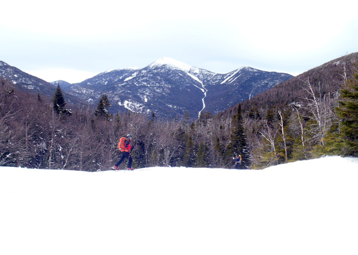 There's a stream below all that snow, a frozen waterfall over the edge, and a fabulous view of Algonquin and others of the High Peaks beyond. (EasternSlopes.com photo)