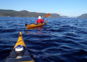 Paddling from the boat launch at Anse de Roche toward Cap Ste. Marguerite (on the right) on Saguenay Fjord. We were on the lookout for whales but didn't see any on this morning paddle. (EasternSlopes.com)
