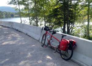 Every inch of the first 10 miles of pedaling from Sainte Rose du nord was uphill. When we finally started down and found this lovely little lake besise the road, we were happy to stop for a few minutes. (Tim Jones/EasternSlopes.com