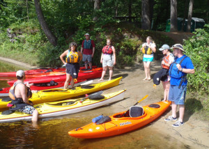 Before the students took to the water, Instructor Jeff Brent of Contoocook River Canoe Co. explains the basics of getting into and out of a kayak in an Introduction to Kayaking course. (EasternSlopes.com)