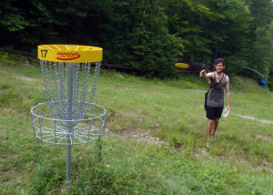 "Visiting from Sydney, Australia, Phil ""tree-nied"" White, who earned his nickname for hitting trees with his flying disc, takes aim at the 17th hole on the championship Disc Golf course at Mount Sunapee in Newbury, NH. He missed the putt and bogied the hole . . . (EasternSlopes.com)"