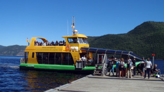 The comfortable ferry boats of the Croisiers duFjord will take you and your bicycle to several stops around the shores of the beautiful Saguenay Fjord in Quebec. This is Baie Eternite in Saguenay National Park. (EasternSlopes.com)
