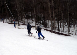 "This father-and-son duo of uphillers were in synch as the skinned up ""Cruiser"" a designated Uphill route on South Peak at Loon Mountain on New Year's Day 2015. (EasternSlopes.com)"