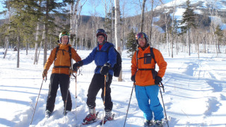 The heart of Brackett Basin is that wooded slope behind us to the left of the visible trails at Sugarloaf . A screaming wind overnight had scoured away most of the powder, but there was still plenty on the runout. (EasternSlopes.com)
