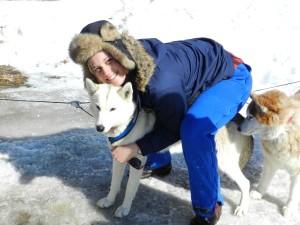 A happy camper with one of Kathy Bennett's Braeburn Siberians. {Photo: Deborah Lee Luskin, EasternSlopes.com]
