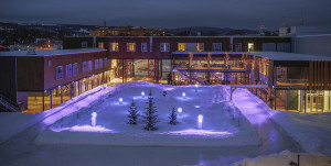 The hotel courtyard is ringed by a skating track and centers a modern, amenity rich ski-and-stay experience. (Le Massif photo)