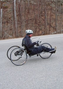 Even if you legs no longer work you can still cycle. Geoff Krill, the winter sports director at New England Disabled Sports at Loon Mountain, who lost the use of his legs in a snowmobile accident shows how it's done in a hand cycle. (EasternSlopes.com)