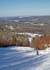 Titus Mountain looks out onto the low hills which roll away to Lake Ontario. This was taken on a weekday when we were among ony a handful of skiers and riders there to enjoy perfect conditions. (EasternSlopes.com)