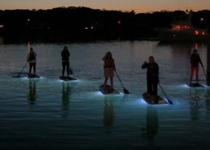 SUP paddling at night  on Oak Bluffs Harbor with Island Spirit Kayaking: lights on the bottom of our Stand-Up Paddleboards made the experience almost dream-like as we floated between sea and sky with fish, crabs, and starfish swimming beneath. (Island Spirit Kayaking )