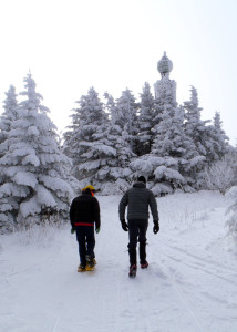 Near Greyock Summit: We'd dropped our packs at the hut just below Greylock's summit, donned warmed clothes, and hiked up the last hundred yards to touch the summit monument. (Tim Jones/EasternSlopes.com