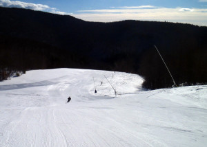 On a cold, bright winter morning, East Slope and adjacent trails at Cranmore Mountain are sunny and sheltered from any wind. (Tim Jones/EasternSlopes.com)