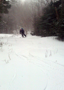 Nicole Simms enjoys sliding down the Gulf Of Slides ski trail in Pinkham Notch, NH, turns she earned by skinning up the trail earlier. (Danielle Jepson/Appalachian Mountain Club)