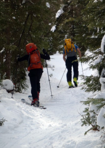 A ski lift is faster and easier, but there's a certain satisfaction to climbing a backcountry ski trail under your own power. Of course skiing DOWN a steep, 6-foot wide trail has its challenges, too. (EasternSlopes.com photo)