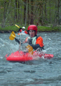 Getting splashed with freezing cold water is just part of the fun of learning how to whitewater kayak. (EasternSlopes.com)