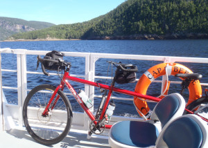 Bikes and ferry boats go together. By taking our tandem touring bike aboard the Crosiere's du Fjord shuttle ferry on Saguenay Fjord, we set ourselves up for a perfect bike ride the next day. (Tim Jones/EasternSlopes.com)