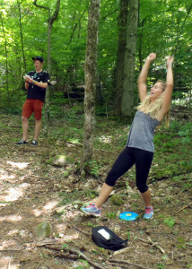 "Alex ""lady arms"" Peters, who is visitng from Sydney, Australia, celebrates as she sinks a put for par on the Disc Golf course at Mount Sunapee in Newbury, NH. Fellow Aussie Max ""pitch and putt"" Halden also applauds her success. (Tim Jones/EasternSlopes.com photo)"