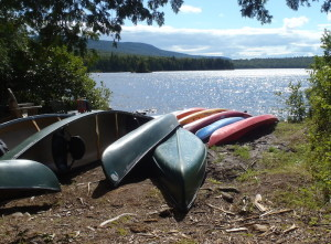On a warm summer day, all these canoes, kayaks and paddle boards are yours to play with at the AMC's Gorman Chairback camp. Just be back in time for dinner! (EasternSlopes.com)